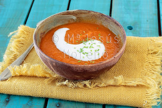 Photo: Carrot cream with yogurt and parsley on wooden blue