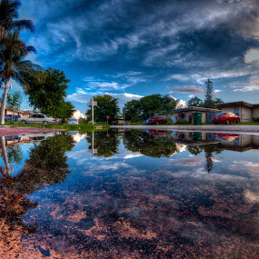 Neighborhood after the rain by Nemanja Stanisic - City,  Street & Park  Neighborhoods ( home, parking, reflection, sunset, cars, neighborhood, house, puddle, homes, hood, palms, reflections, people, places, architecture, building )