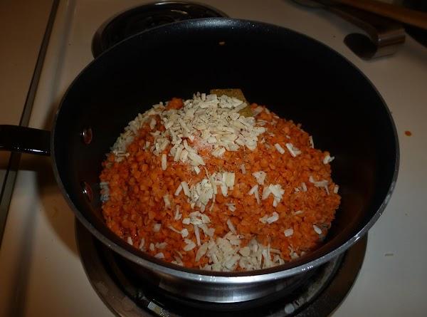 In a pot over medium heat (or a rice cooker) melt the butter. Add...