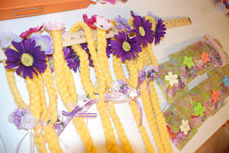 Photo: Hair braids for the girls to decorate with flower barrettes