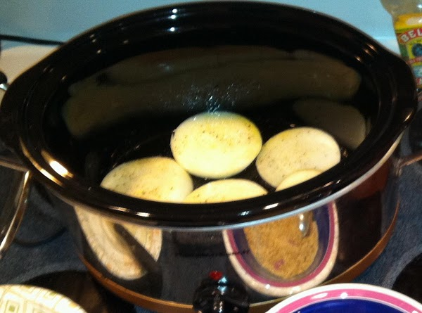 Slice one onion in to fourths.  Place onion on bottom of crockpot to...