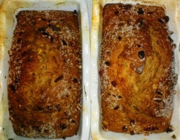 Separate evenly into two loaf pans. Optionally sprinkle pecans, kosher salt, and turbinado sugar...