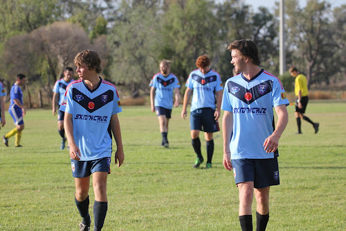Matt Hall and Todd Bailey leading Namoi off the field at half time on Saturday.