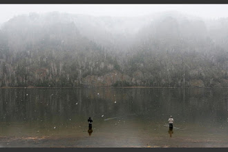 Photo: Men fish in the waters of the Yenisei river during snowfall in the Siberian town of Divnogorsk, Russia, May 2, 2016. REUTERS/Ilya Naymushin     TPX IMAGES OF THE DAY