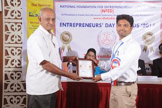 Photo: Chief Patron to NFED, Shri. R. Soundararajan Issuing Sponsor Plaque To Mr. Saravanakumar. V., Co-Founder & CEO, Bonfirng, Coimbatore