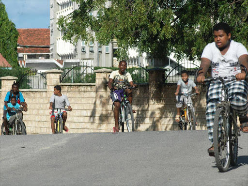 Boys ride bicycles in Mombasa town yesterday as they take time to relax during the April holidays. /ANDREW KASUKU