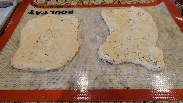 Take balls of dough and pat or roll it out into roughly a 6x10...