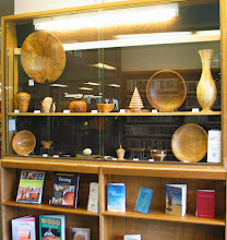 Photo: The Aspen Hill Library is displaying work by Tim Aley, Phil Brown, Bob Browning, Bert Bleckwenn, Bob Grudberg, Gary Guenther, Ed Karch, Russ Iler, Paul Mazzi, Jeff Tate, Richard Webster, and Stan Wellborn.  Books on woodturning and wood working are on view on two shelves under the left side.