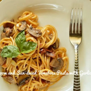Mushroom And Sun-dried Tomatoes Pasta With Garlic Sauce.