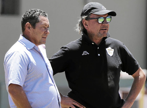 Going places: Stellenboach FC coach Sammy Troughton, right, and his assistant, Steve Barker, plot their team's strategy ahead of the promotion playoffs. Picture: BACKPAGEPIX