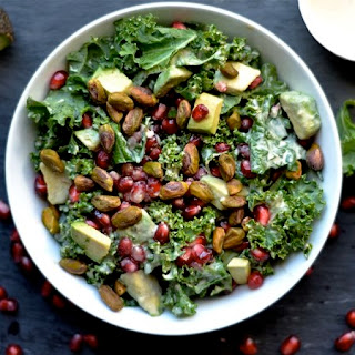Kale, Pomegranate, and Avocado Salad with Zesty Tahini Dressing.