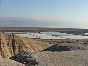 Photo: A view from the cave area towards agriculture plantings, shaded from the sun.