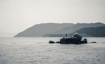 Photo: A Japanese fisherman fishing in the Seto Inland Sea