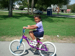 Photo: Kaleya is learning to ride a bike - she has the basics down.