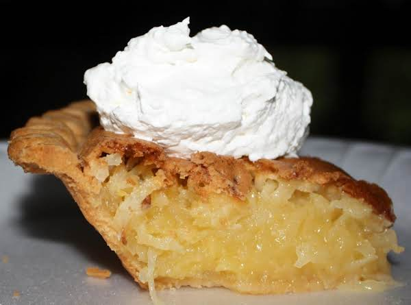 Toasted Coconut Pie.  Garnished With Whipped Cream.