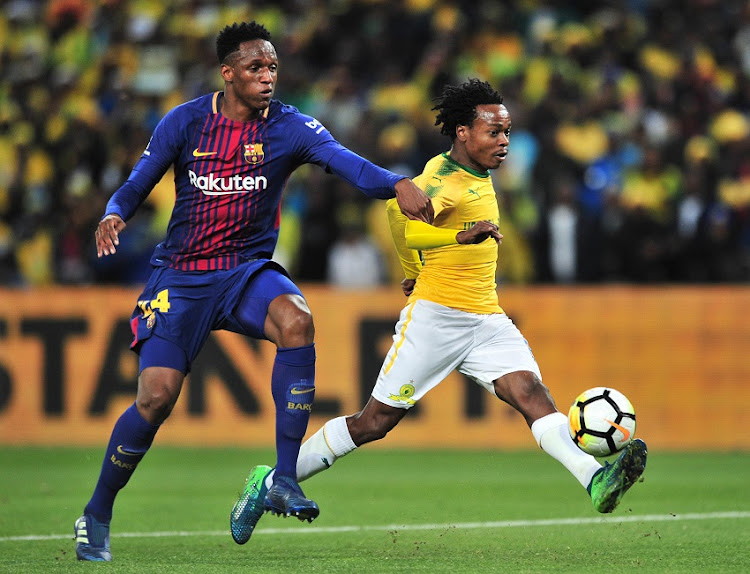 Percy Tau of Mamelodi Sundowns challenged by Yerry Mina of Barcelona during the 2018 Mandela Centenary Cup Friendly match between Mamelodi Sundowns and Barcelona at FNB Stadium, Johannesburg on 16 May 2018.