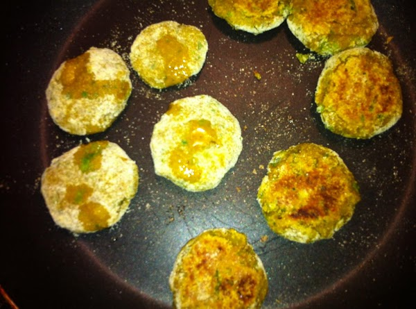 Dip and coat the patties in corn meal and arrange them on the pan....