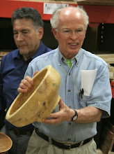 Photo: Phil Brown shows off two box elder salad bowls that he made from wood he picked up from members.  This one from Mike Colella and ...
