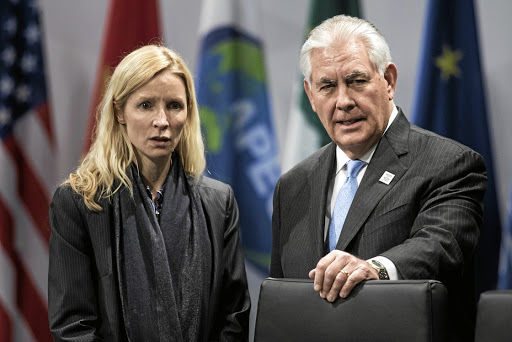 Diplomatic debut: US Secretary of State Rex Tillerson, right, and his chief of staff Margaret Peterlin wait for an opening session meeting of G-20 foreign ministers in Bonn on Thursday. Picture: REUTERS