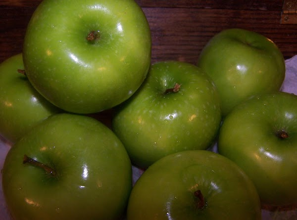 Preheat oven to 375F. Place peeled, cored and sliced apples in large bowl. Squeeze...