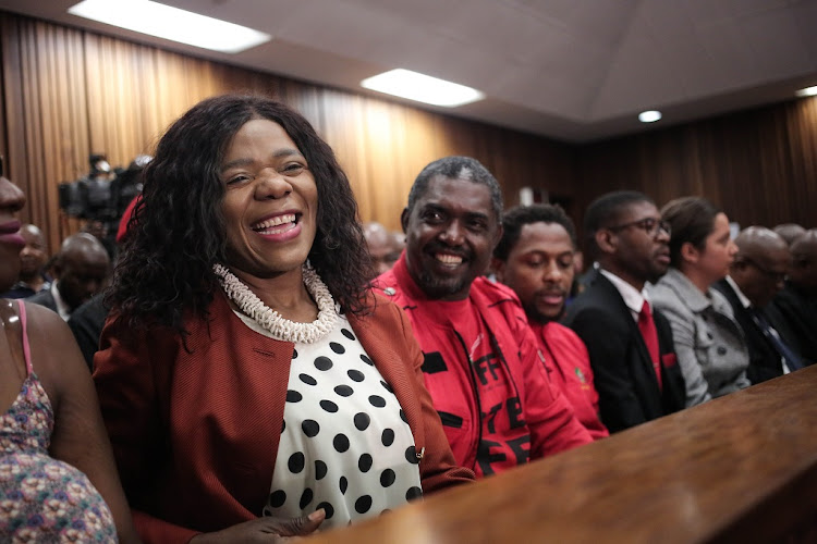 Former Public Protector Thuli Madonsela shares a light hearted moment when taking her seat next to EFF Secretary General Secretary Godrich Gardee and EFF national spokesperson Mbuyiseni Ndlozi at the North Gauteng High Court in Pretoria, December 13 2017. Picture: ALAISTER RUSSELL