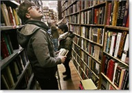 Customers peruse the goods at The Strand bookstore in New York City. Photo by Seth Wenig, AP.