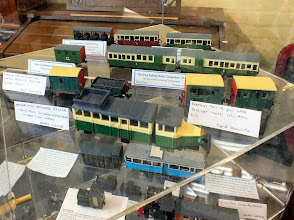 Photo: 024 Display photo 8, One of several Corgi toy bus railcar conversions by Garry Whiting, rolling stock by David Hennessey and on the rear rows, some Festiniog coaches by Steve Nixon that were judged runners up in the rolling stock section .