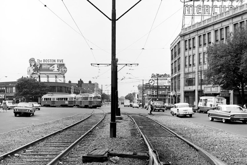 Photo: On July 23, 1962, a green line trolley was coming east around Packard's Corner, and a couple fellows crossed Comm Ave, perhaps heading for the Tastee Freez truck.