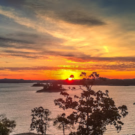 Sunrise on Broken Bow by Jennifer  Loper  - Instagram & Mobile iPhone ( orange, sunrise, broken bow, blue, yellow, clouds, oklahoma, lake, water )