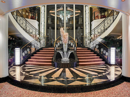 The elegant grand staircase on your Oceania Cruises ship.