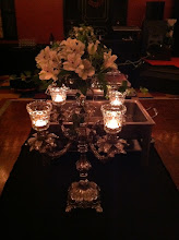 Photo: Candleabra with vintage votives and bowl of flowers