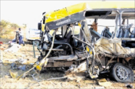 WRECK: This Bahwaduba Bus Services bus was involved in an accident with a Malawian truck on the N1 outside Polokwane yesterday. Nine people are reported to have died at the scene while the injured were taken to hospitals in Polokwane. Pic: ELIJAR MUSHIANA. 18/06/2009. © Sowetan. HORRIFIC:The remains of an accident involving the Mahwaduba Bus Services which collided head on with a Malawian truck on the N1 road outside Polokwane on Thursday (yesterday). Nine people were reported died at the scene while injured were rushed to Polokwane Hospital. PHOTO: ELIJAR MUSHIANA