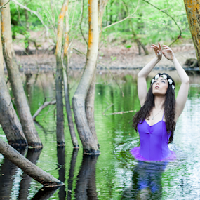 The Lady of the Lake by Antony Sendall - People Portraits of Women ( water, reflection, model, flowers in hair, beautiful, arms raised, purple tutu, ethereal, lake, tut, ballerina, woods, curly hair, amazing, fantasy, sexy, black hair, legend, arthurian, trees, lady, stunning )
