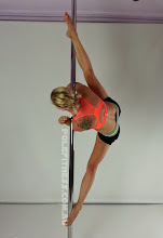 Photo: Aleksandra Deren - Straddle with Double Corner Elbow - Vertical Pole Gymnastics at Pole Fitness Studios Sydney Australia