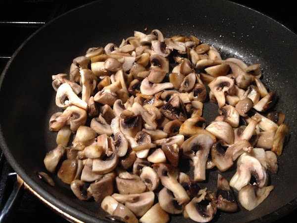 IN A LARGE PAN  HEAT BUTTER WITH OLIVE OIL N SAUTÉ MUSHROOMS UNTIL...