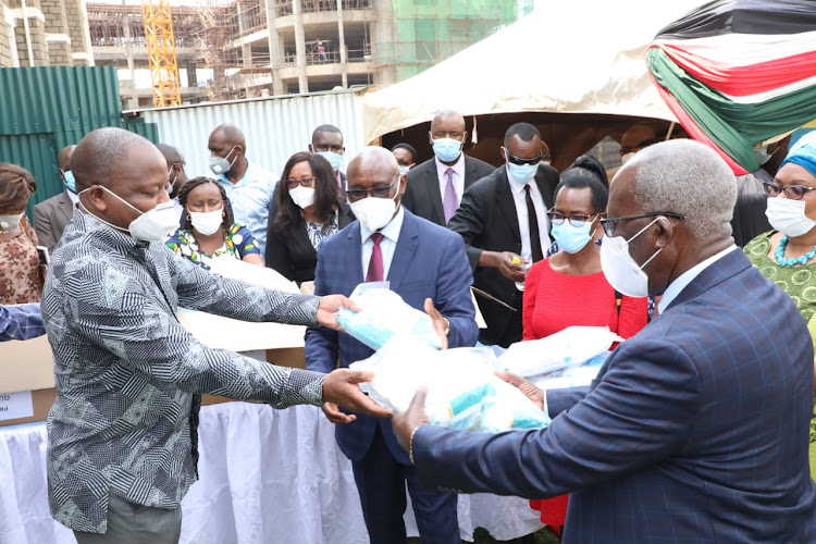 Health CS Mutahi Kagwe hands over PPEs to Kisii senator Sam Ongeri and Governor James Ongwae at Kisii Teaching and Referral Hospital yesterday.