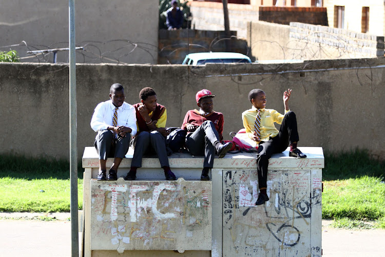 Soweto pupils relax at a local park while their teachers are away on a Sadtu march. The teachers' union is coming under increasing scrutiny.