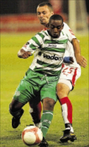 Hero: Bloemfontein Celtic's Patrick Malokase dribbles past Ajax Cape Town's Brett Evans during their PSL match recently. Malokase is expected to give Chiefs defence a hectic time this afternoon.07/02/07. \n Photo by Tertius Pickard. ©  Gallo Images. \n