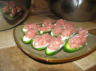 Top peppers with the ground pork mixture to hold in the cream cheese.