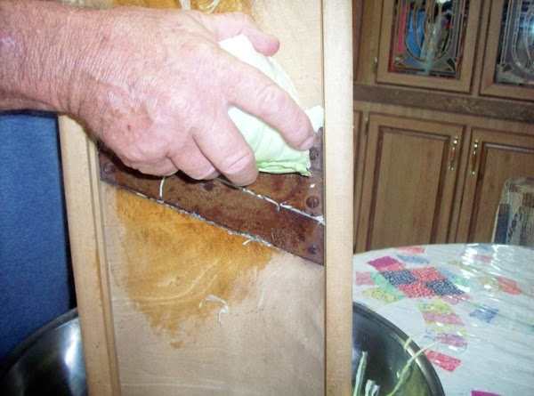 Shred on kraut cutter or cut with large knife, really thin strips. Use one...