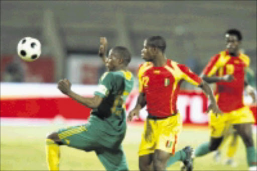 CHASING: Bafana Bafana's Sibusiso Zuma, left, fights for the ball with Guinea's Camara Alseny in their friendly game at Super Stadium last Tuesday. Pic. Antonio Muchave. 10/09/08. © Sowetan.