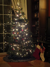 Photo: The finished tree! Please note ears to the left of the stockings.