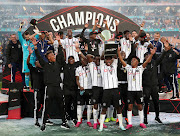 Orlando Pirates players celebrates after winning the Carling Black Label Cup after beating Kaizer Chiefs at FNB Stadium in Soweto on Saturday July 27 2019.