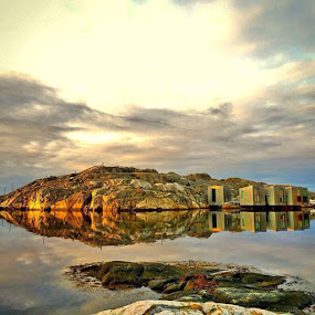 Cliffs in the evening Sweden by Eva Larsson - Landscapes Waterscapes ( cliffs reflections huts sky nature cost water )