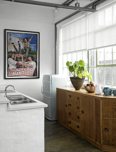 A vintage sideboard adds essential storage space to the kitchen.