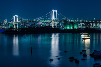 Photo: Blue Night on the Rainbow Bridge  Went out to Odaiba last night with a local friend who is getting into photography. The weather was lovely and it wasn't too crowded which is always nice. Thankfully the air is still clear (i.e. not humid) so there was good visibility for this photo. In the background you can see the Tokyo Tower, which is currently lit up pink for Sakura season.  Blog post: http://lestaylorphoto.com/blue-night-rainbow-bridge/  #cooljapan #100tokyo