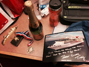 Photo: My prizes for calling in and answering a trivia question on the morning show - cheap champagne, a ship on a stick and the cruise director's autograph!