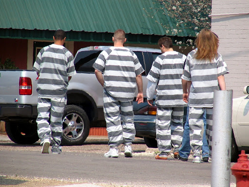 Government classifies non-white inmates as white