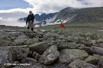 Photo: Crossing a stream on their way down from the summit of Snøhetta