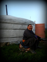"""Photo: Regional Nadaam Wrestling and Horse Riding Champion Mr. Bold, my third host. The man has hands the size of dinner plates!  Nadaam is the yearly """"manly games festival,"""" where young men compete in horse-racing, wrestling, and archery. This year's wrestling champion was on the cover of Mongolian GQ at the supermarket."""